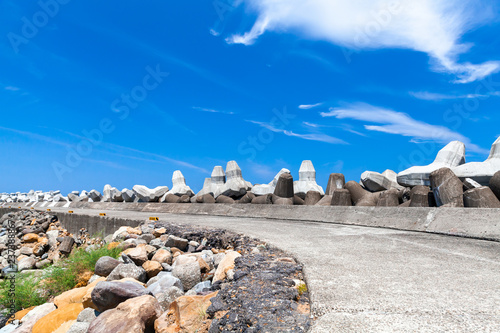 Breakwater structure with road and concrete blocks - 237388867