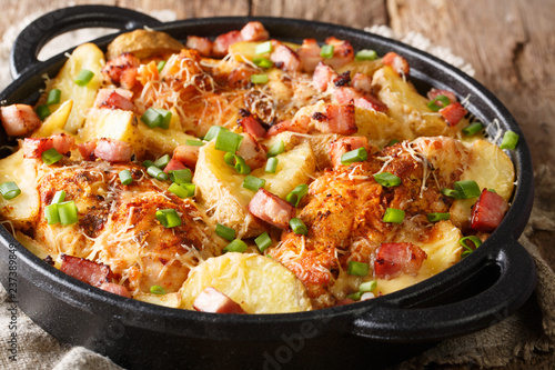 Delicious ranch casserole of chicken fillet with potatoes, bacon and cheese close-up in a pan. horizontal - 237389849