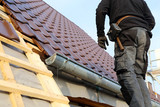 Tiling a roof - 237390806