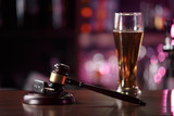 Car key on the table next to a glass of beer drinking driving Concept. The concept of a drunk driver. in the tinted