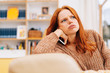 Leinwanddruck Bild - Confused young redhead woman