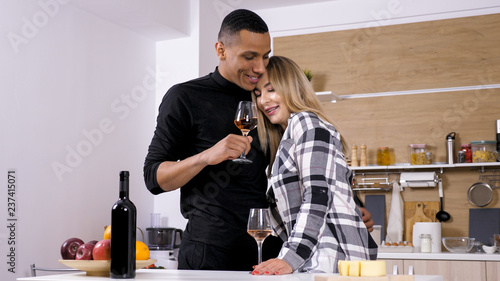 Beautiful woman showing affection to her boyfiend on their romantic dinner. Beautiful emotions - 237415071