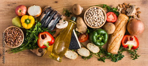 Healthy eating. Mediterranean diet. Fruit,vegetables, grain, nuts olive oil and fish on wooden table. Top view. Panoramic view