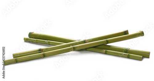 Green bamboo sticks isolated on white, side view