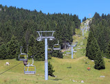Chair lift leading to the top of the mountain - 237431008