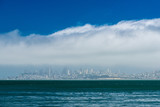 the city of San Francisco sits beneath a layer of fog