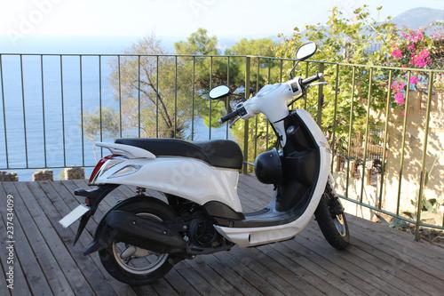 Simple Motorbike parked near the sea