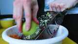 Man is rubbing an apple on a grater, preparing a salad of vegetables at home, slow motion - 237438462