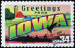 Greetings from Iowa postcard on postage stamp