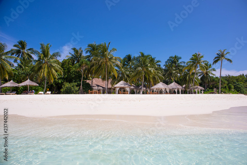 White sand beach and crystal clear water in the Maldives