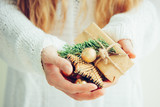 Woman's hands hold christmas or new year gift box. - 237451809