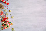 Christmas background with confetti, christmas balls, and red gift boxes on the white wooden board - 237457233