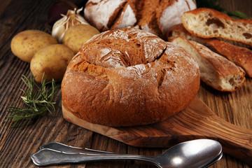 Homemade potato cream soup, served in bread bowl.