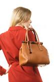 Female wearing red dress holding bag