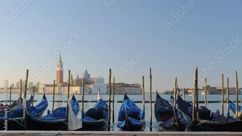 Extreme wide shot of gondola boats in Venice Italy at their moorings on the sea