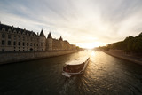 Tourist boat tour on Seine river with beautiful sunset in Paris . Cruise ship sightseeing along river in Paris, France.