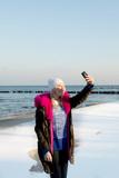 Beautiful young teen girl having fun and making selfie.