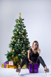 Beautiful girl model celebrates Christmas or New Year in studio