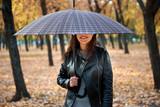 Pretty woman posing with umbrella in autumn park. Beautiful landscape at fall season. - 237502825