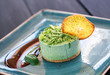 Delicious mint cheesecake with candied fruit and jam on plate