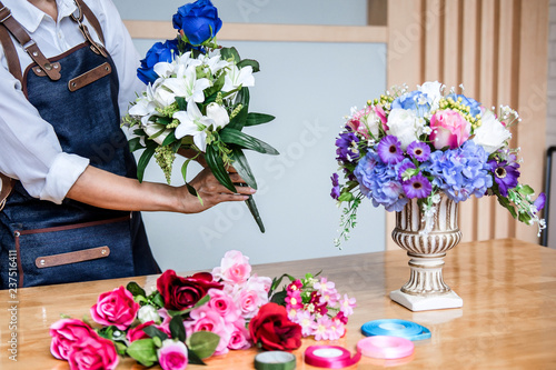 Arranging Artificial Flowers Vest Decoration At Home Young Woman