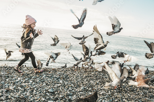 little girl with a pigeons - 237521273