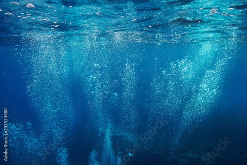 Air bubbles underwater rising to water surface, natural scene, Mediterranean sea, France