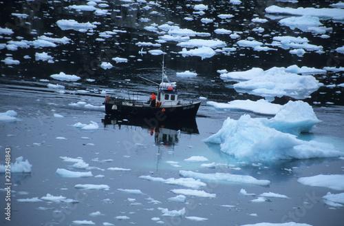 A fishermen between the icebergs
