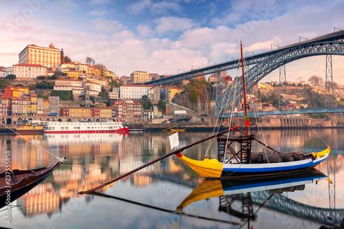 Fototapeta Porto, Portugal. Cityscape image of Porto, Portugal with reflection of the city in the Douro River during sunrise.