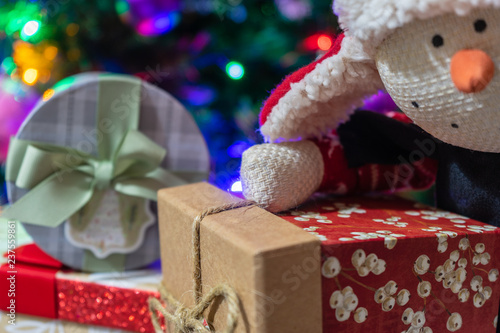 Christmas presents under the tree.Christmas gifts for whole family.Snowman Plush Toy