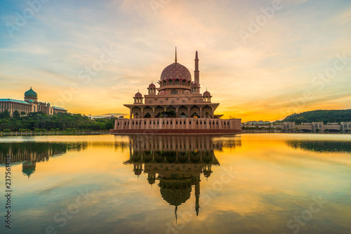 fototapeta na ścianę Sunrise view of the Putrajaya Mosque with reflection. soft focus,blur due to long exposure. visible noise due to high ISO.