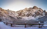 Snowy Tatra Mountains in winter frosty landscape. Mountain lake Morskie oko