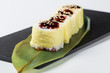 Yellow maki sushi on green leaf