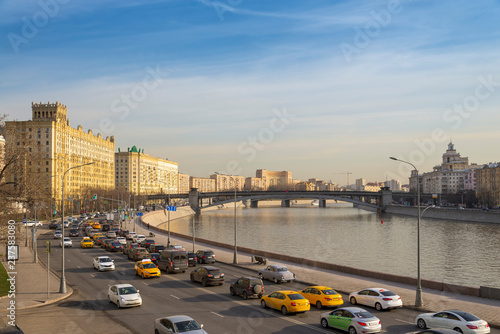 traffic jam on embankment moskva river in Moscow city russia, sunset time