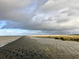 North Sea Shore in East Frisia (Ostfriesland) with Dramatic Clouds and Light