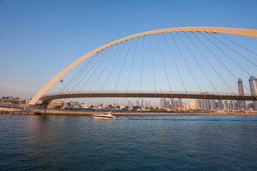 Dubai city skyline at sunset. view of Tolerance bridge