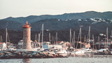 Macinaggio harbour with red lighthouse at sunset - 237593094