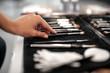 Leinwandbild Motiv Makeup artist is taking professional brush for applying shadows with natural pile
