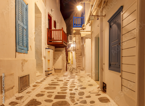 Greece. Mykonos. The old narrow street at sunset.