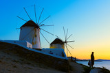 Windmills on the seashore in Mykonos at sundown - 237600664