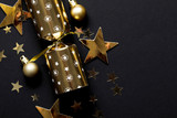 Gold festive Christmas crackers on a dark background