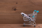 shopping cart with car, buy or rent car