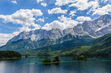 Small islands on the Eibsee, Wetterstein mountains with Zugspitze and Waxenstein in the background.