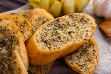 fragrant garlic bread on a rustic wooden background