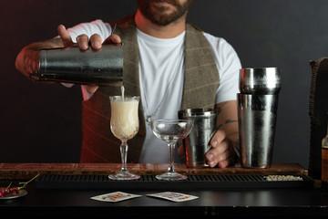 Professional barista prepares cocktails