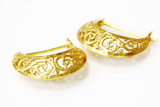 Gold jewelry on white background.