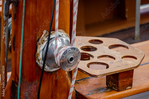 Wooden sailboat on the blue mediterranean sea Details of a classic beautiful sailing yacht with ropes knots and wood plank on deck