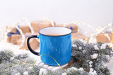 Blue mug with hot  tea, coffee or cocoa on winter holidays background - 237686469
