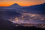 Mt. Fuji and Suwa lake at sunrise seen from Mt. Takabochi