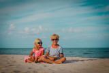 happy cute little boy and girl enjoy beach vacation